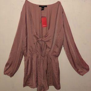 A dusty pink jumpsuit